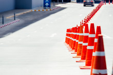 The Orange Cone Is An Object Of The Forbidden Parking Where The Orange Cone Is Located For The Car Parked In This Area.