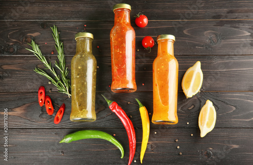 Fotografie, Obraz  Composition with tasty sauces on wooden background, top view