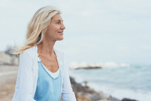 Attractive Middle-aged Blond Woman At The Seaside