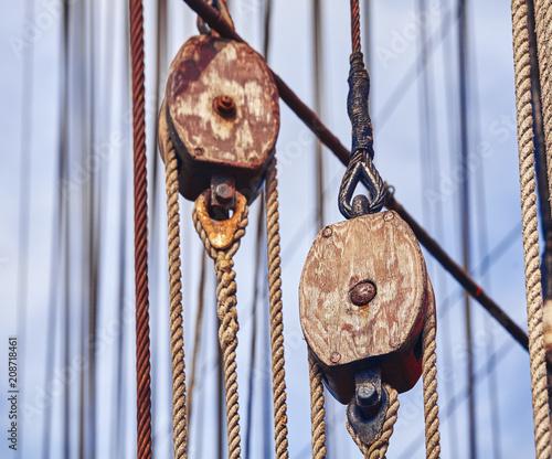 Keuken foto achterwand Schip Vintage toned old sailing ship wooden pulleys, nautical background.