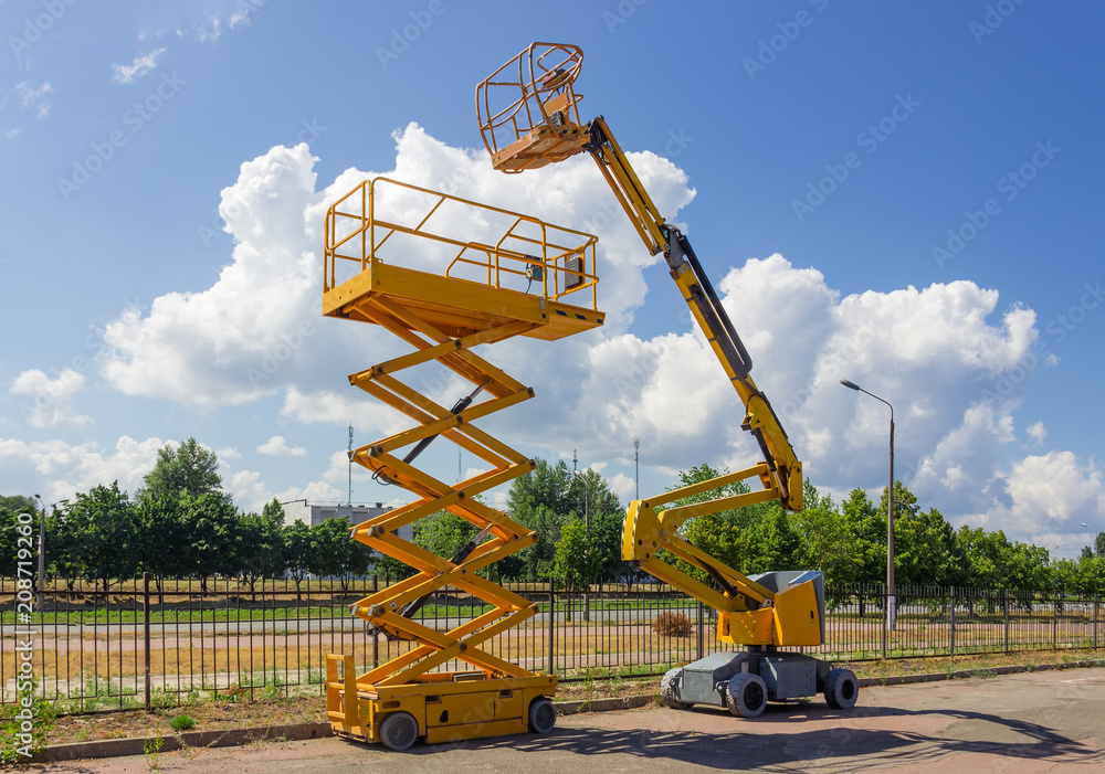 Fototapety, obrazy: Self propelled wheeled articulated boom lift and scissor lift