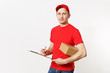 Delivery man in red uniform isolated on white background. Male courier in cap, t-shirt holding pen, clipboard with papers document, blank empty sheet, cardboard box. Receiving package. Copy space.