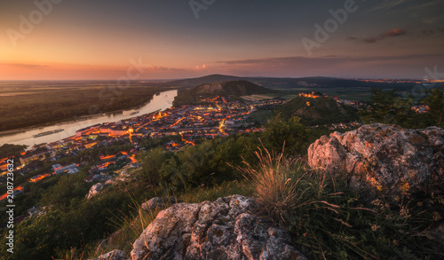 Foto op Aluminium Zalm View of Small City of Hainburg an der Donau with Danube River as Seen from Rocky Hundsheimer Hill at Beautiful Sunset
