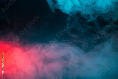 Poster Fumee Colorful smoke on a black background closeup
