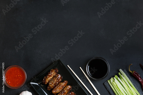 Fotografering Traditional Asian stir fry wings with sesame