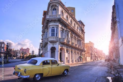 Street with old buildings and a retro car. Havana. Cuba.