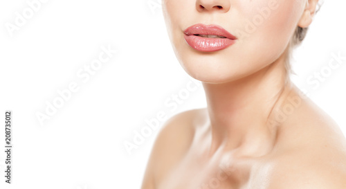 beautiful female lips with lip gloss and nacked shoulders on white background