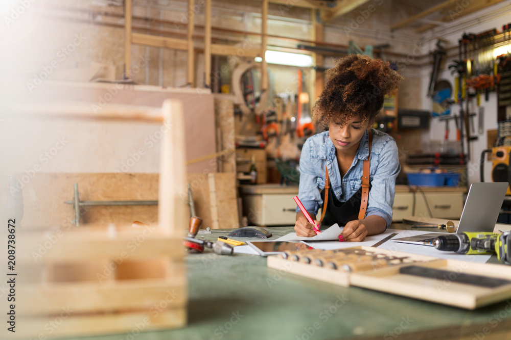 Fototapety, obrazy: Afro american woman craftswoman working in her workshop
