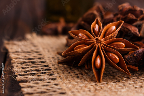 anise stars on a dark rustic background Wallpaper Mural