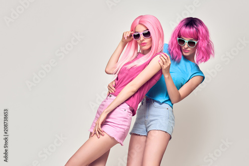 Two Girls Having Fun Dance. Pink Fashion Hairstyle Poster