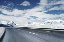 Empty Asphalt Road With Snow M...
