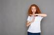 Leinwandbild Motiv Pensive young woman gesturing with her hands