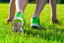 Sports Shoes Sneakers On A Fresh Green Grass Field. Sport Equipment Bottom View. Sports In The Open Air.