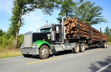 Logging Truck Driving Fast In Rural Georgia On The Way To The Paper Mill.