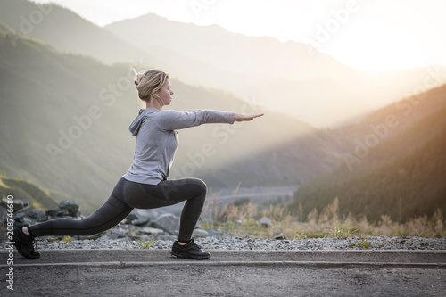 Fotografia  Exercising adult woman outdoors. Sports and recreation. Fitness.