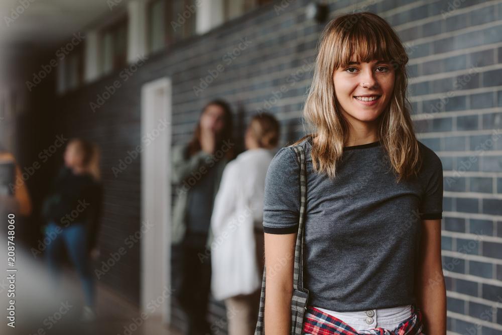 Fototapeta Female student in university campus