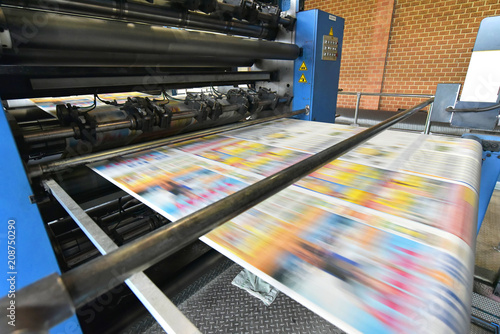 Obraz na plátně  newspaper printing with a roller offset printing machine in a printing house //