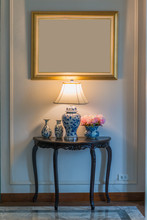 Beautiful Table Lamp And Old Ceramic Vase On Vintage Wooden Table With Gold Frame Classic Interior Decoration