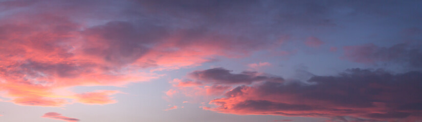 Dramatic colorful dawn/dusk sky, with dark clouds, panorama background.