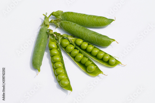 Vászonkép Three pods of peas with exposed seeds and three full pods