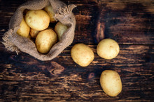Raw Potatoes In A Linen Bag On...