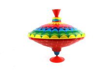A Vintage 1970s Children's Spinning Top In Rainbow Colours On White