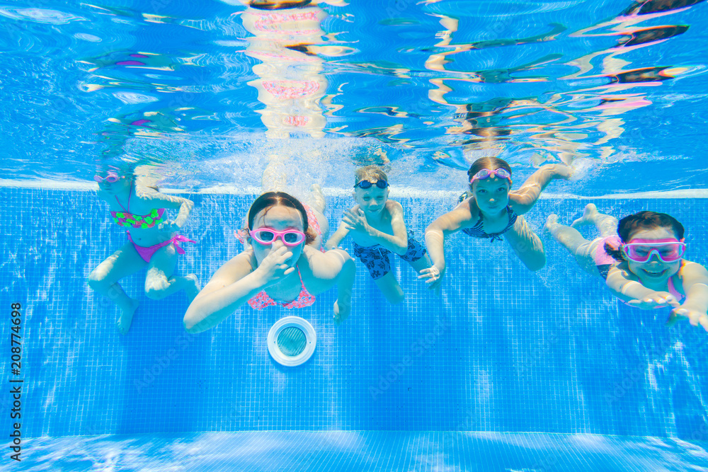 Fototapeta Children swim in  pool