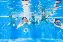 Children Swim In  Pool
