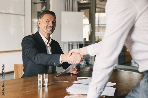 Fotografie, Obraz  Business, career and placement concept - satisfied director man 30s smiling and