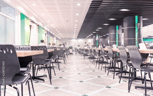 Foto Modern interior of cafeteria or canteen with chairs and tables