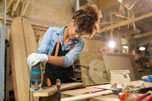 Obraz Afro american woman craftswoman working in her workshop