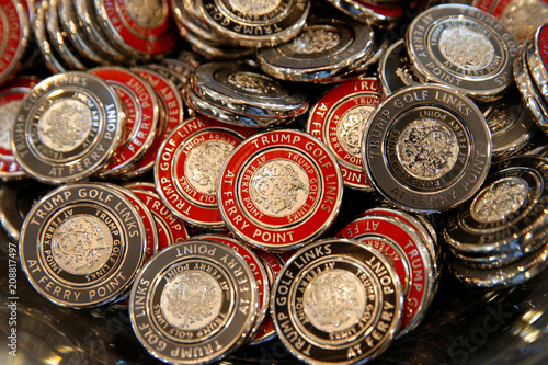Challenge coins are displayed for sale in the clubhouse at