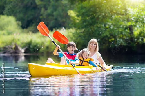 Child on kayak. Kids on canoe. Summer camping. Wallpaper Mural