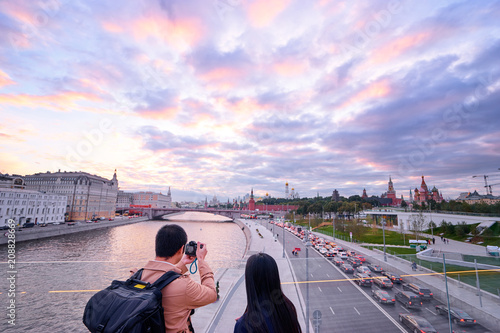 Traveling by Russia. Young man and woman taking photo and enjoying Kremlin and Moscow River view.
