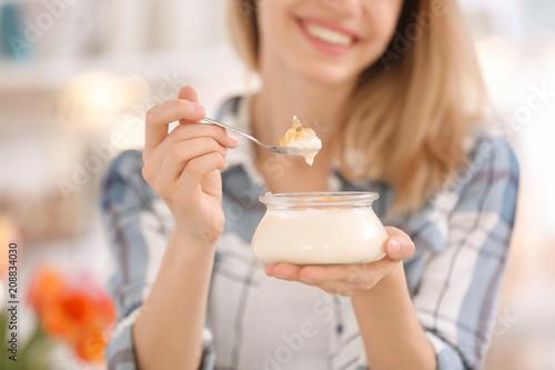 Fototapeta Young woman eating tasty yogurt, closeup obraz
