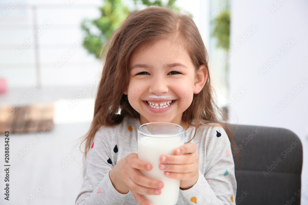 Fototapety, obrazy: Cute little girl with glass of milk indoors