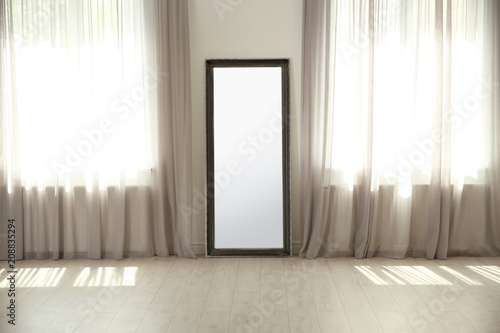 Fototapeta Stylish room interior with large mirror and elegant curtains obraz