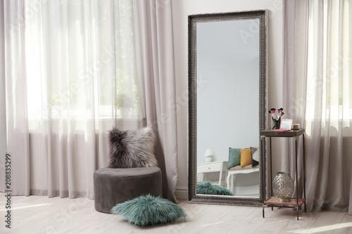 Obraz Stylish room interior with large mirror and elegant curtains - fototapety do salonu