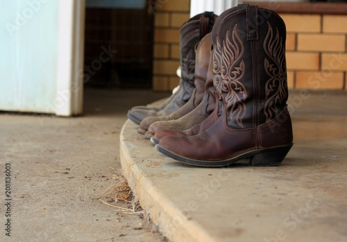 56e21454927 Womens leather cowboy boots removed outside after used on the farm ...