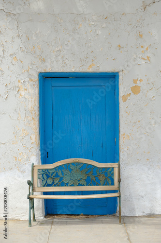 Foto op Plexiglas Theater Blue door and white wall at an old Opera House in the California Desert
