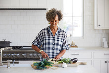 African American Senior Woman Cooking In The Kitchen