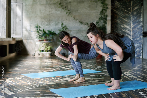 Girl with Down syndrome practicing yoga