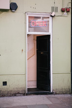 Open Door With Security Camera And 'Open' Sign