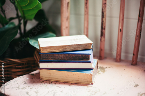 Old Books stacked on Chair