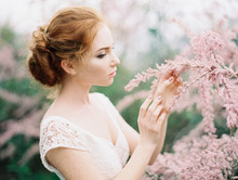 Woman Posing In Dress With Flower