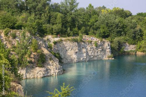 Fototapeta Lagoon Zakrzowek in an old limestone quarry, emerald water, resting people, Krakow, Poland obraz