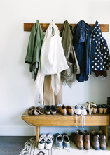 Hanging Rack With Artistic Coats And Shoes