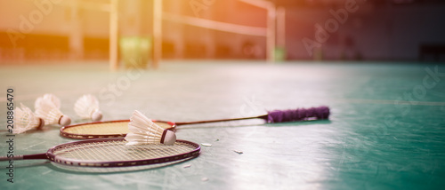 Badminton ball (shuttlecock) and racket on court floor Canvas Print