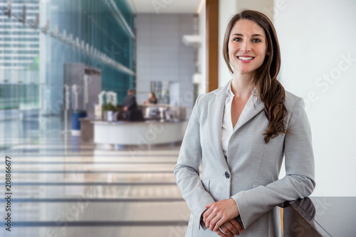 Fotografie, Obraz  Cute commercial business corporate representative woman model brunette smiling i