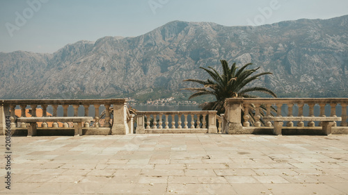 Spoed Foto op Canvas Mediterraans Europa Bay of Kotor,Montenegro.Rustic stone mediterranean balcony -terrace with view on mountians and bay.